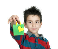 Boy who laughs and holds Shopping bag with heart. Royalty Free Stock Photos