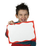 Boy who laughs and holds white board Royalty Free Stock Photo