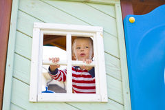 Boy who is looking out in a window of a children's Royalty Free Stock Photography