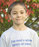 Boy Who Loves To Read. A boy wearing a shirt that says, 'I've read a whole bunch of books royalty free stock photo