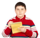 Boy who writes on a notepad Royalty Free Stock Image