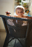 Boy in a wicker chair3 Royalty Free Stock Photo