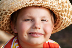 Boy in a wicker hat Royalty Free Stock Images