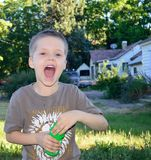 Boy wide open mouth laughing royalty free stock photo