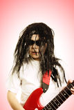 Boy in wig with red guitar Stock Photo
