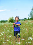 Boy with wild spring flowers Royalty Free Stock Photo