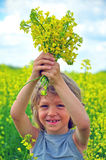 Boy with wildflowers. Smiling boy with some wildflowers Stock Photography