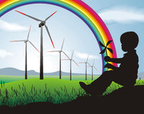 Boy and Wind turbine Stock Images