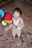Boy & windmill Stock Image