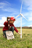 Boy with windmills and spade on the field Stock Photography