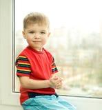 Boy on window Stock Photo