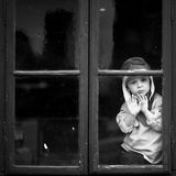 Boy on the window, laughing and drinking tea Stock Photo