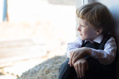The boy at the window Stock Photography