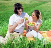 Boy with wineglass and girl with fruits Royalty Free Stock Photography