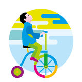Boy on a winged bicycle Royalty Free Stock Image