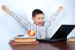 Boy winner in computer game or learning Royalty Free Stock Images