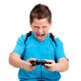 Boy with winning attitude playing video console. Boy shouting and showing winning attitude while playing with video console. Isolated on white Royalty Free Stock Photo