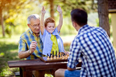 Boy is winning in chess game. At park Stock Photography
