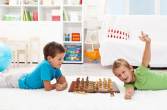 Boy wins chess game Stock Image