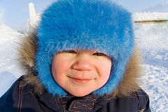 Boy in winter clothes. Boy in winter clothes, outdoors in winter Royalty Free Stock Photography