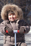 Boy in winter clothes Stock Photography