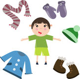 Boy with winter clothes collection Royalty Free Stock Photography