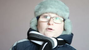 Boy in winter clothes stock video footage