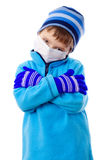 Boy in winter clothes and medical mask. Sad boy in winter clothes and medical mask, isolated on white Stock Image