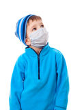 Boy in winter clothes and medical mask. Boy in winter clothes and protective medical mask looking sideways, isolated on white Stock Photography