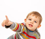 Boy in winter clothes pointing Stock Image