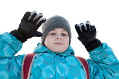 A boy in winter clothes  on a white background Stock Photography