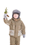 A boy in winter coat with a branch of fur tree Royalty Free Stock Photo
