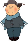 A boy in a winter coat and a fur cap. The little boy in a fur cap Royalty Free Stock Photo