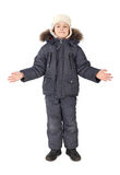 Boy in winter dress standing hands at sides Royalty Free Stock Photography