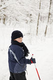 Boy in winter forest Stock Images