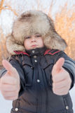 Boy in the winter hat shows gesture all is well Stock Photos