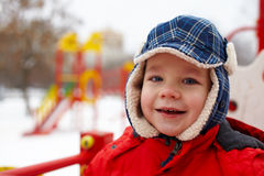 Boy in winter park Royalty Free Stock Image