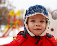 Boy in winter park Royalty Free Stock Images