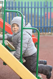 Boy in winter park Royalty Free Stock Photography