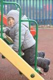 Boy in winter park Stock Image