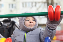 Boy in winter park Royalty Free Stock Photos