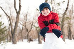 Portrait of a boy in a winter park Stock Image