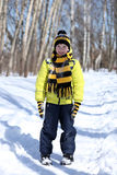Boy in a winter park Stock Photo