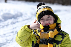 Boy in a winter park Stock Images
