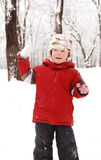 Boy in winter park plays snowballs Stock Photos