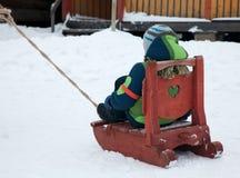 Boy in a winter sleight. Little boy is sitting in a winter sleight Royalty Free Stock Photo