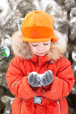 Boy at the winter walk, keeps the snow. The little boy at the winter walk, keeps the snow in your hands. New year, holiday, Christmas Stock Photos