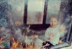 Boy in winter window Stock Photos