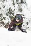 Boy in a winter wonderland Stock Image