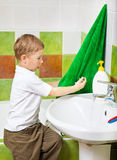Boy wipes hands a terry towel after washing Stock Photo